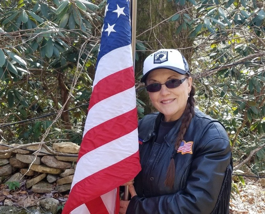 Ann M. Wolf with Flag